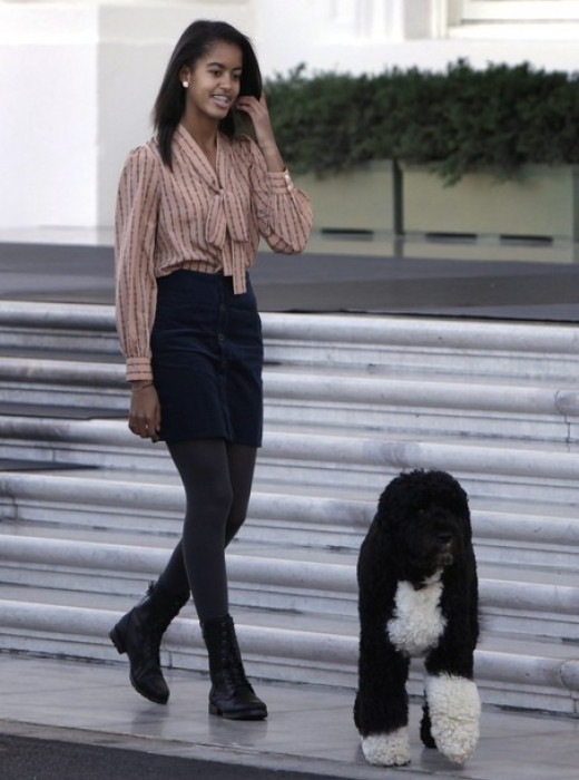 First daughter Malia Obama with family dog