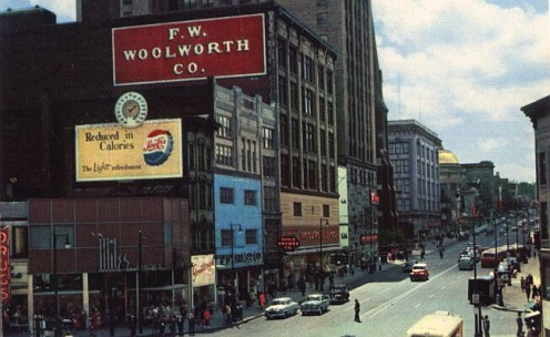 "Vintage photo of the ""Busy Corner"" of town during the only year that Woolworth's was open in Utica."