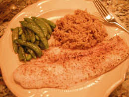 Basic broiled fish served with fresh sugar snap peas and Cajun dirty rice.