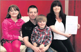 My family in the local paper talking about autism.