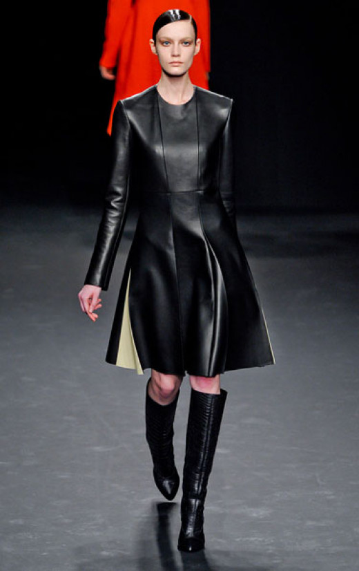 This black leather dress is edgy and girly.