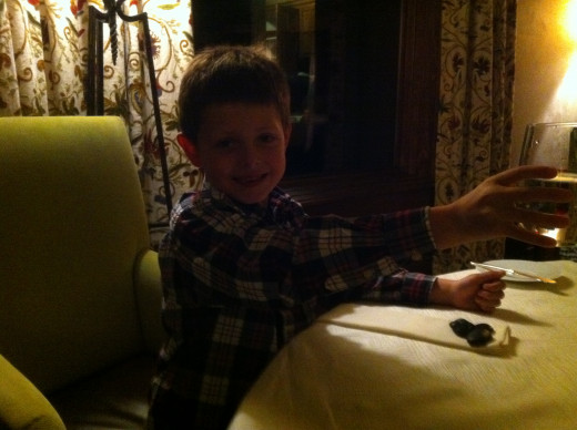 Our middle son, feeling confident as he reaches to cheers with me during New Year's Eve dinner.