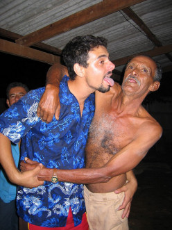 You cannot be arrested in your own home by  showing a drunk man the length of your tongue.