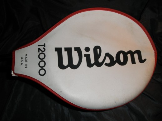 Here is the original Wilson T2000! This racquet is awesome and is very desirable to a wide range of tennis collectors because of its status symbol of the evolution of tennis equipment. These sell very well on Ebay