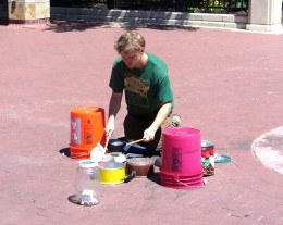A drummer using typical household instruments rather than drums.