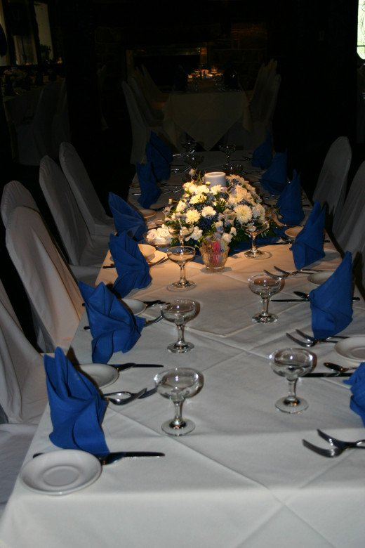 A table set for the reception in the River Room.