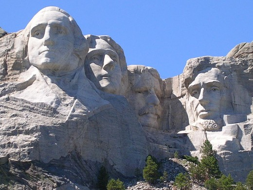 Mount Rushmore National Monument in the Black Hills of South Dakota. The four United States presidents carved in the granite rock are George Washington, Thomas Jefferson, Teddy Roosevelt, and Abraham Lincoln.