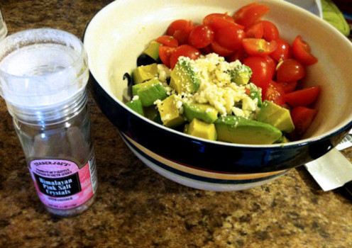 Put the sturdy ingredients on the bottom, cucumber and olive first, then avocado, tomato, feta.