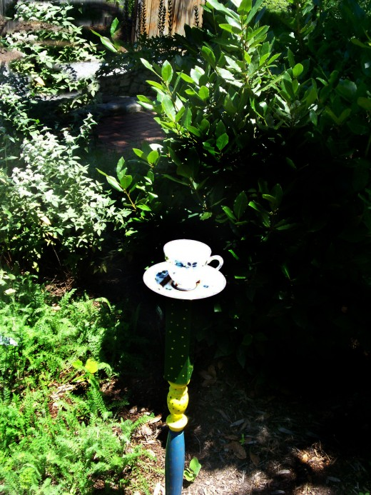 Garden Tea Cups. For a child's garden or an English garden; The cup and saucer is always a fun addition. Pick up the cups and saucers at yard sales and also the mallet that holds them!  (Glued solid, of course!)