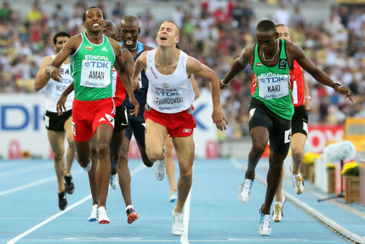 (L-R) Mohammed Aman of Ethiopia, Marcin Lewandowski of Poland and Abubakar Kaki of Sudan duck for the line during the men's 800 metres semi finals in Daegu, South Korea 2011.