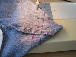 Sewing the corners to make a square bottom.