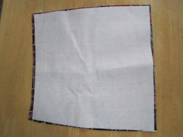 """Cutting the iron-on interfacing 1/4"""" smaller all round prevents the iron-on glue from going off the edge of the lining and sticking to your ironing board cover."""