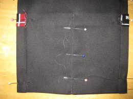 f.  Continued--sew down the center of the small pocket, neatly ending seam at top.