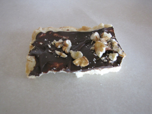 Shortbread cookies with chocolate and nuts on top.