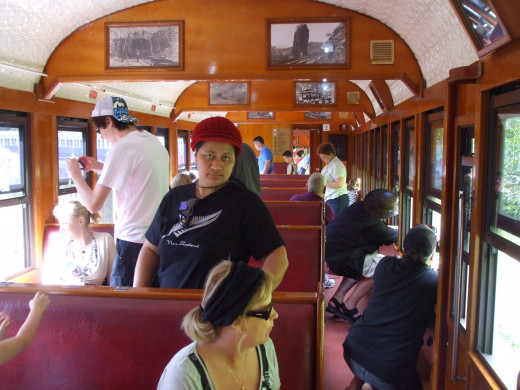 Kuranda Scenic Railway carriage with historical pictures lining the walls