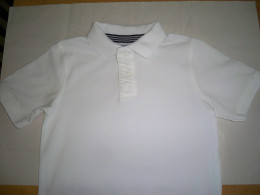 Size 5 polo style t-shirt.