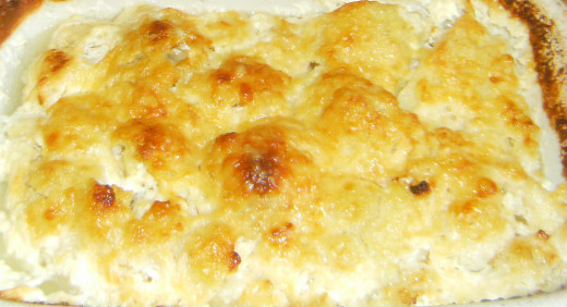 Cooked potatoes with cheese and milk