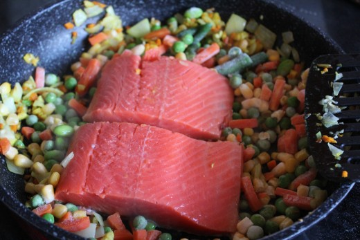 Chop the salmon into chunks as it cooks.