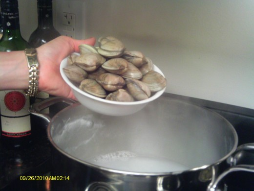 Add the mussels (or clams) last with a small quantity of water to steam.