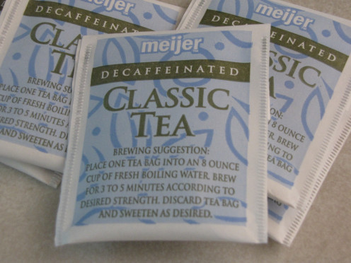 Regular tea bags do the trick.  I usually drink decaf, but you can use any kind you would like.