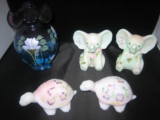 Mulberry vase, Lotus Mist Burmese elephants, and Blue Burmese Turtles.