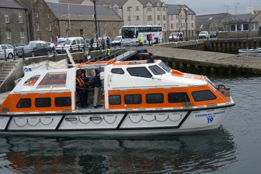 A Caribbean Princess tender in Kirkwall harbour (Orkney Islands, Scotland) in 2012. These tenders are covered.