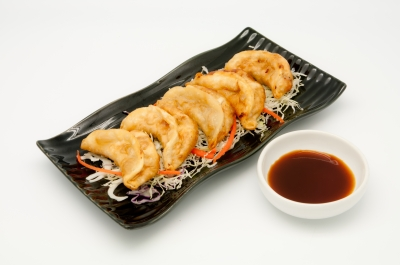 Chinese dumplings are commonly accompanied by a rice vinegar based dipping sauce.