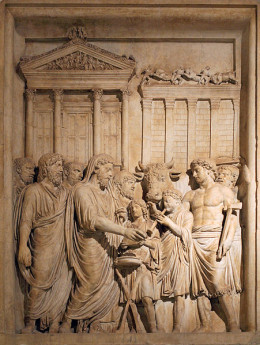Emperor Marcus Aurelius (161-180 AD) and the Imperial family offer sacrifice in gratitude for success against Germanic tribes. In the backgrounds stands the Temple of Jupiter on the Capitolium.  Bas-relief from the Arch of Marcus Aurelius, Rome.