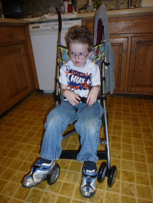 Our son is nearly five years old, and has no obvious signs of needing assistance with walking. He has significant fatigue issues and uses a stroller when he cannot walk.