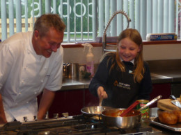 Martha with Nick at his cookery school.