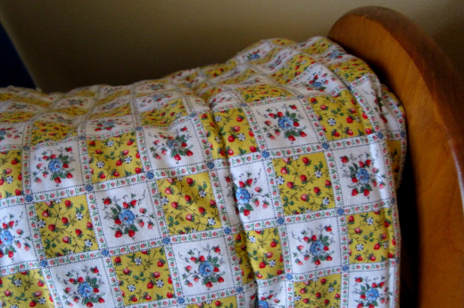 Grandma's quilt in the corner.