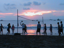 Beach volleyball at sunset on Playa Tamarindo.  People often play soccer on the beach as well.  Boats tow behind floats that hold about 8 people on many beaches as well.