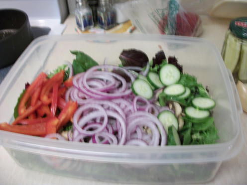 Step 1 and 2.  Mix in the red pepper, red onion, and English cucumber with the Spring mix and mushrooms.