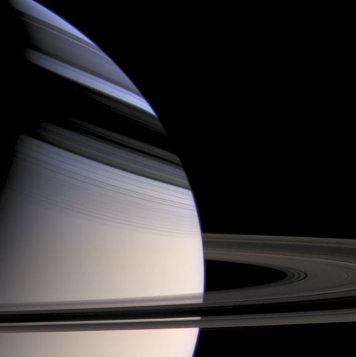 The rings of Saturn cast shadows on its northern hemisphere during part of the planet's orbit. Snapped from 621,000 miles away.