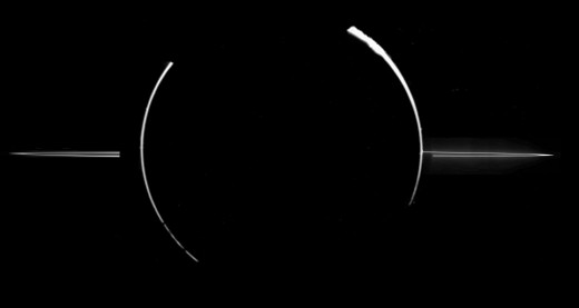 Jupiter's main ring, about 4350 miles wide, is about 80,000 miles from the center of the planet. (Jupiter's radius is about 44,000 miles, and Earth's radius is 3963 miles.)