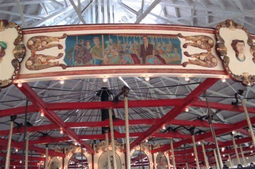 "A panel by artist Cortlandt Hull depicting ""Walking Distance"" on the carousel in Recreation Park"