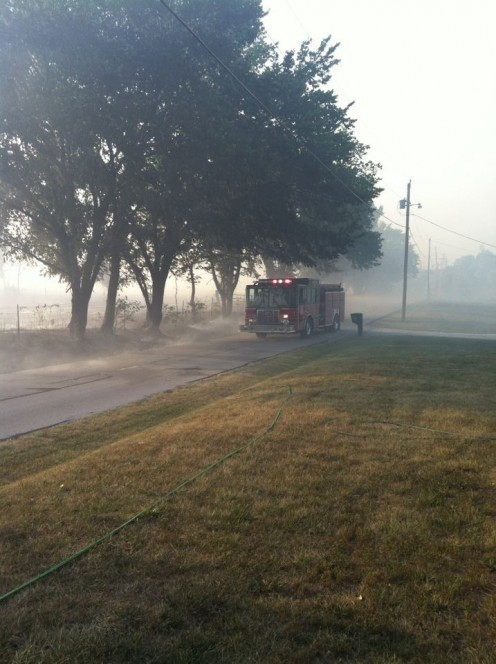 One of the Fire Engines Passing Our Front Yard