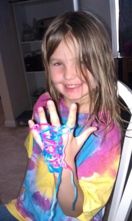 My oldest daugher doing her finger knitting :)