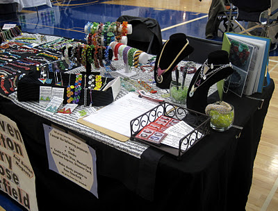 In addition to including contact information with my online orders, I provide my information cards at shows in my business card holder and include them in customer purchase bags.