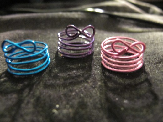 Infinity rings in blue, purple and pink