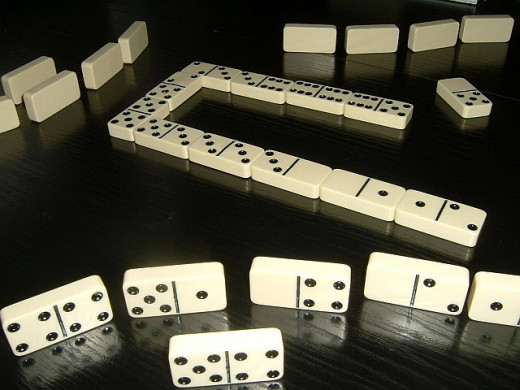 The game of dominoes is a great game to teach to your grandchildren.