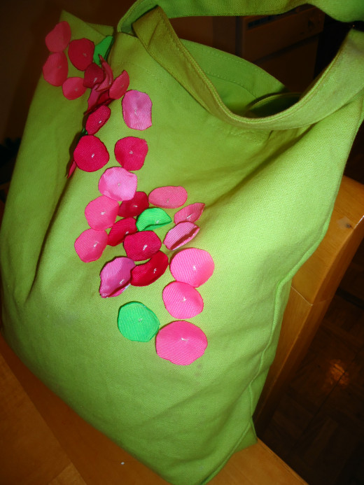 Lime green canvas bag with a single layer of grosgrain ribbon circles sewn on. I like how they look like scattered flower petals.