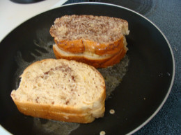 After dipping the sandwich in the egg mixture, grill it on each side in a pan with the melted butter.