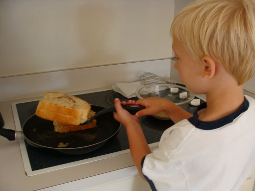 With close supervision, I allowed Alex to try his hand at flipping the sandwich.