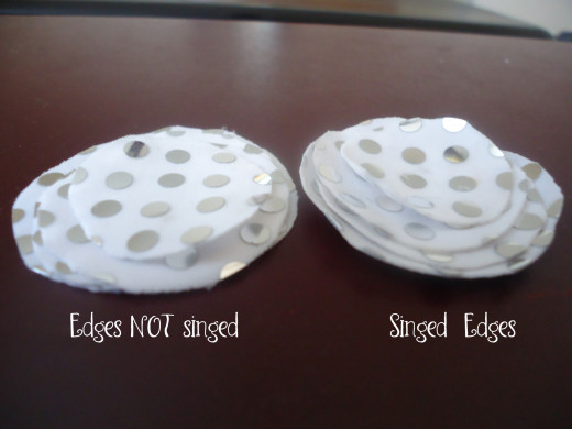 The one on the right is singed- notice how the edges pull up... and it takes on a sort of cup shape.