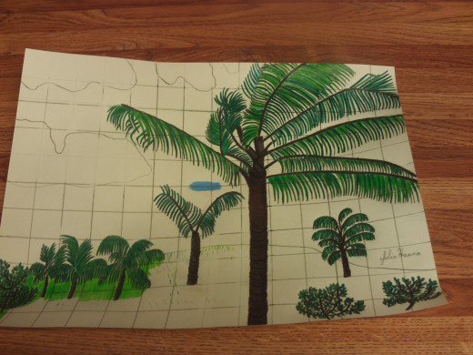 Now I am coloring in the grass surrounding the bushes and the palm trees.