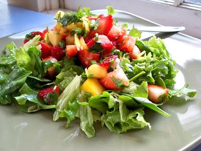 Put the mango salad above out on a bed of mixed greens for the perfect mango strawberry salad.