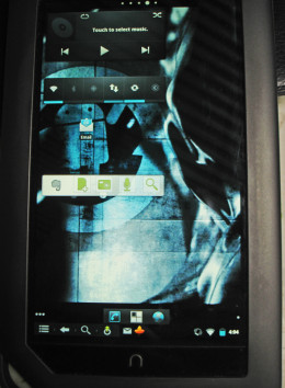 My Nook Color with Gingerbread - Cyanogen Mod 7 installed, plus a few widgets that I have put on.  I still have a lot more widget customization to do, but it is a functional tablet with bluetooth and has applications that I needed, like Evernote.