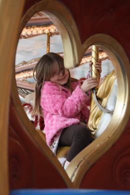 My oldest daughter on the carousel