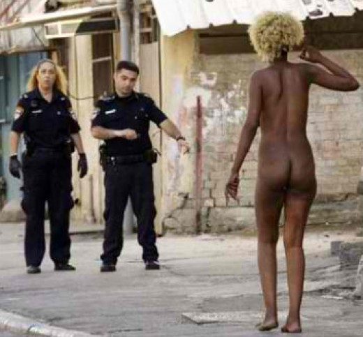 Israeli Police Confront a Naked African